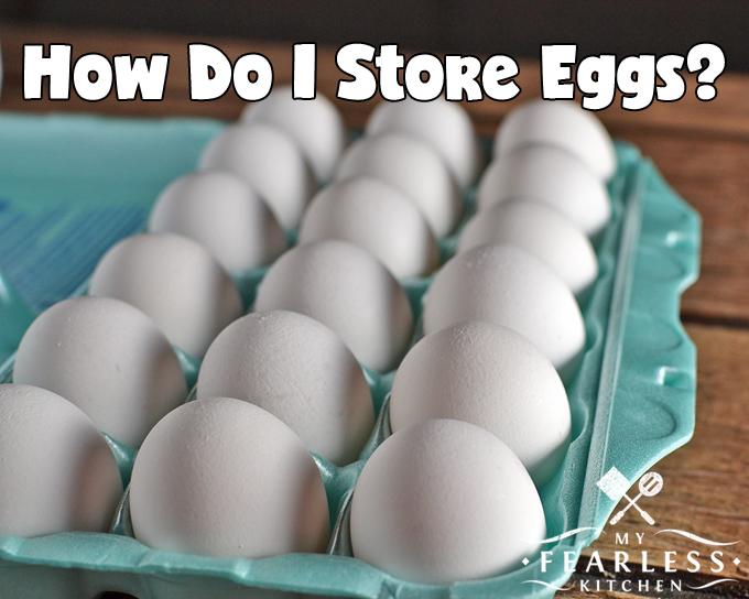 white eggs in a blue egg carton