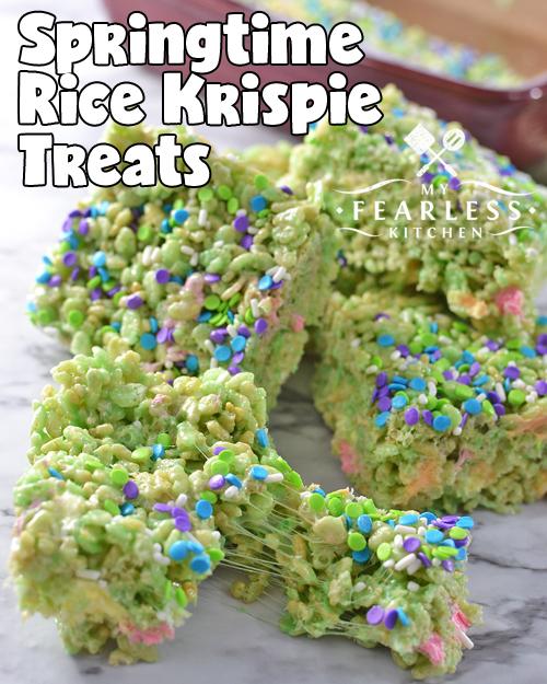 gooey marshmallow green rice krispie treats on a marble background