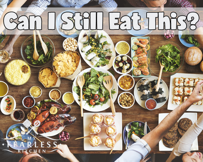 lots of different types of food on a wood table