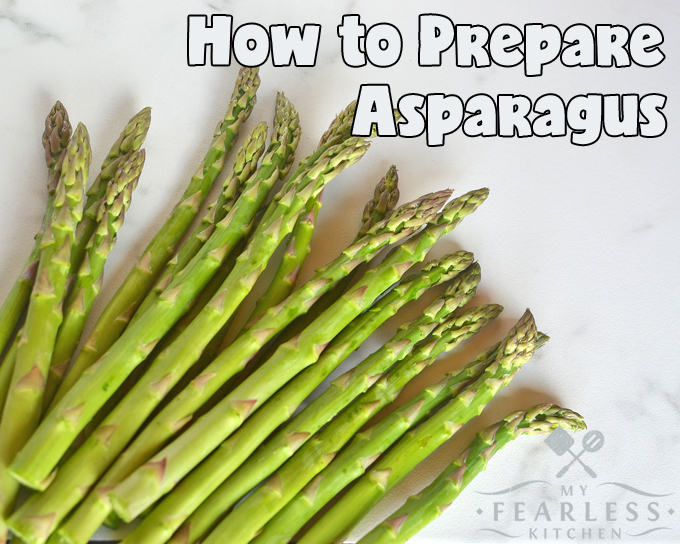 fresh asparagus spears on a white marble background