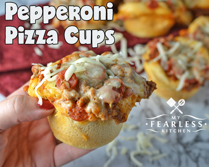 hand holding a pepperoni pizza cup with mozzarella cheese