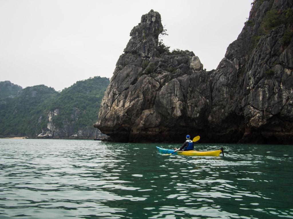 Small kayak, big rock, Ha Long Bay.