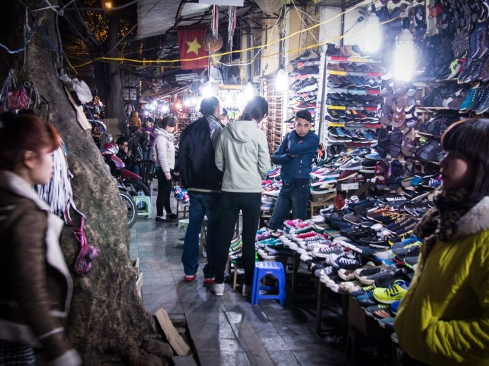 Selling shoes, Hanoi.