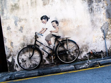 Famous bicycle art in George Town. I am happy to bestow a little downhill on these kids.
