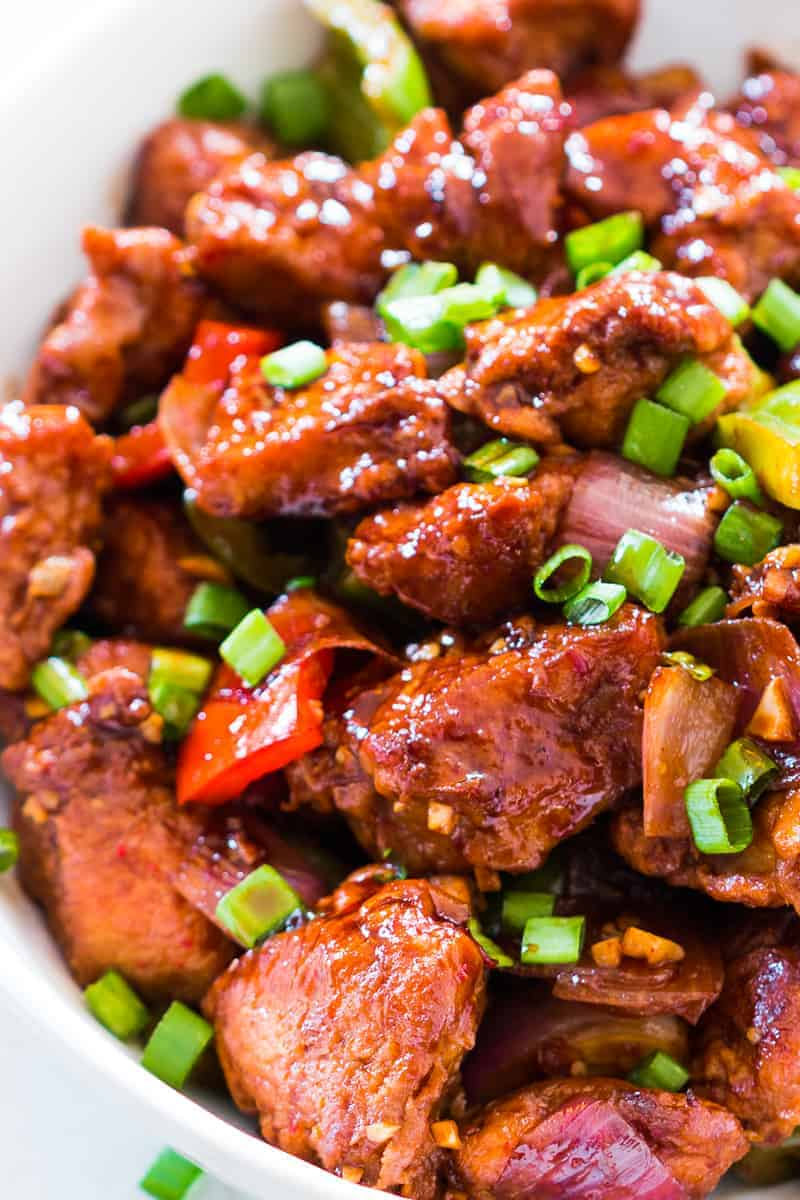 Easy recipe for Indian Chinese Chilli Chicken Dry. This will give you fool proof restaurant style chinese chilli chicken dry every time! It's sweet and sour, crispy and spicy. You can also make it with gravy, but dry is our favourite.