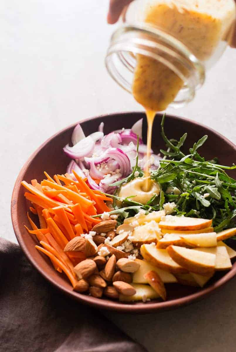 Apple Arugula Almond Salad with Orange Marmalade Dressing is a quick, easy healthy salad like waldorf but better. Add chicken, kale or cranberry to mix things up!