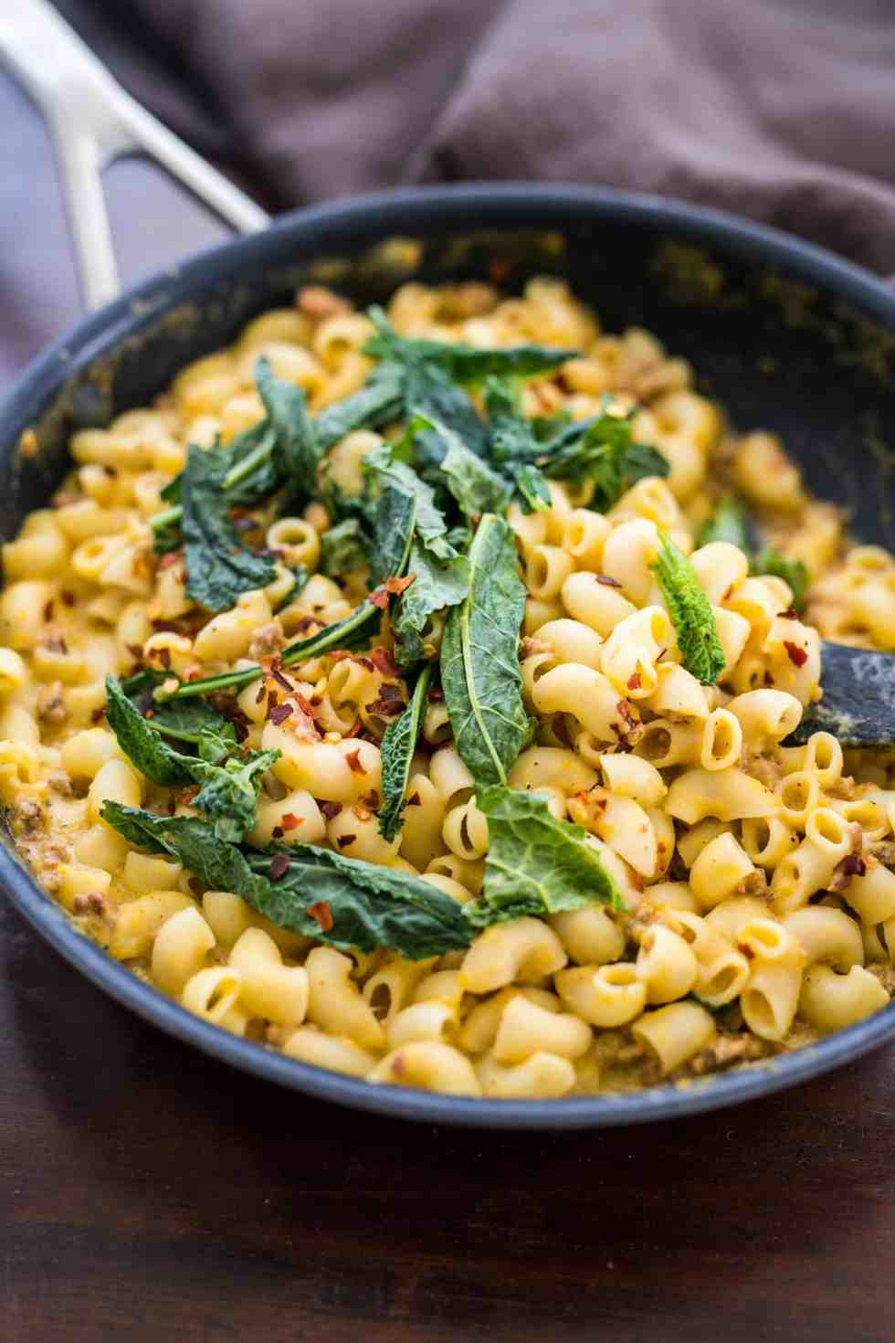 Creamy pumpkin sausage mac and cheese with kale is pure comfort food! It's a fast, easy dinner recipe when you crave homemade pasta in a bowl.