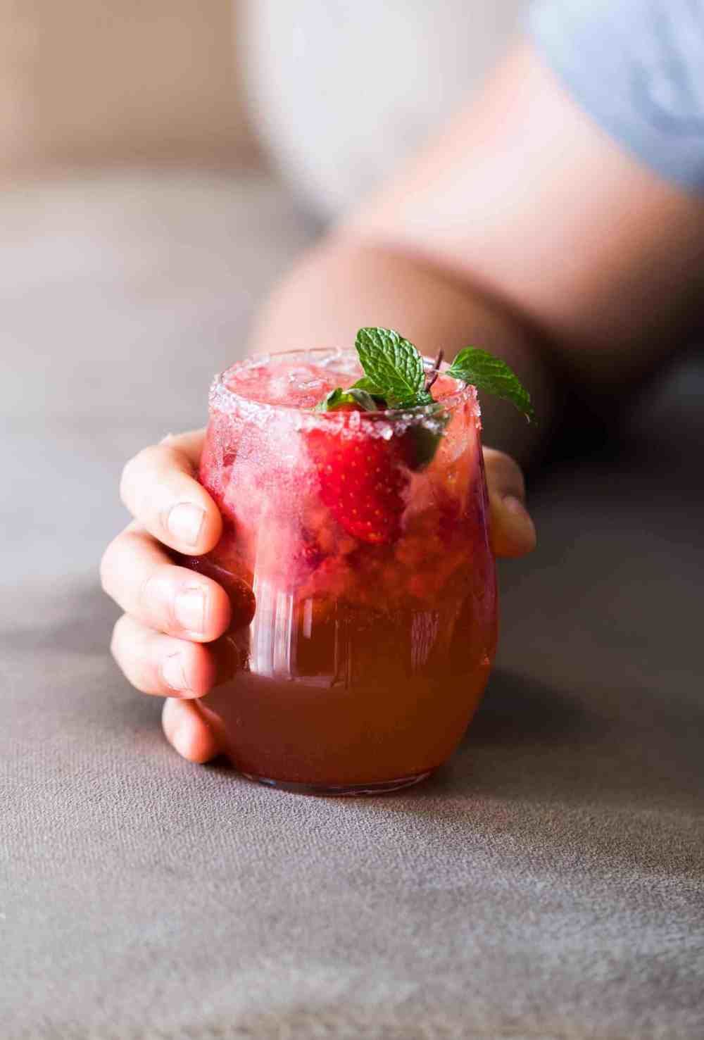Mint Strawberry Moscow Mule is the perfect summer cocktail. Made with vodka and ginger beer it's super easy and our go to drink these days!