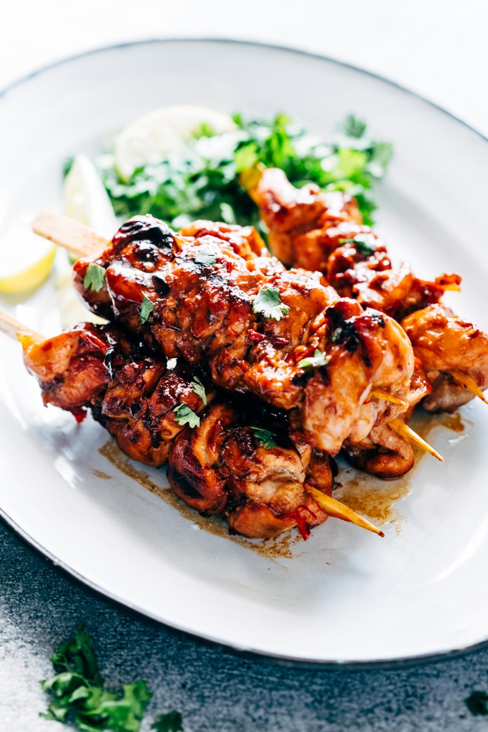 Grilled Sambal Chicken Skewers is an easy, 5 ingredient recipe thats spicy, sweet and sticky! Its a chinese style recipe with sambal oelek, soy sauce and lemon grass.