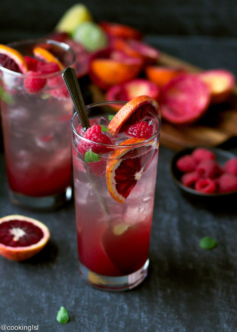 Mojitos are the perfect summer cocktails, and this one comes with blood oranges and raspberry making it tartly sweet and delicious!