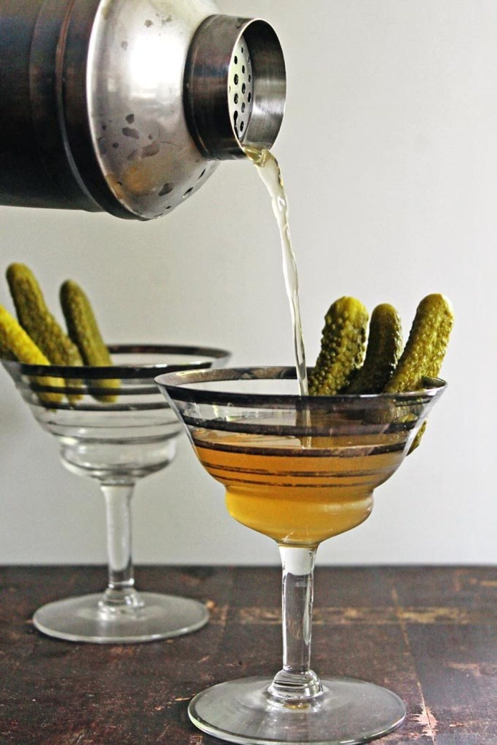 Love a hint of spice in your drink? This martini is a pickle infused drink making it herby and peppery!