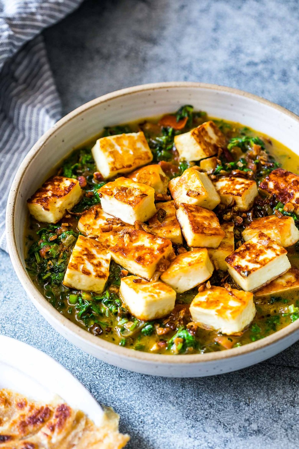 You are going to love this healthy saag paneer which is an easy, Indian recipe thats full of flavour and uses a combination of mustard greens or arugula and spinach. It's gluten free, ready in 30 minutes and is perfect with naan or parathas.