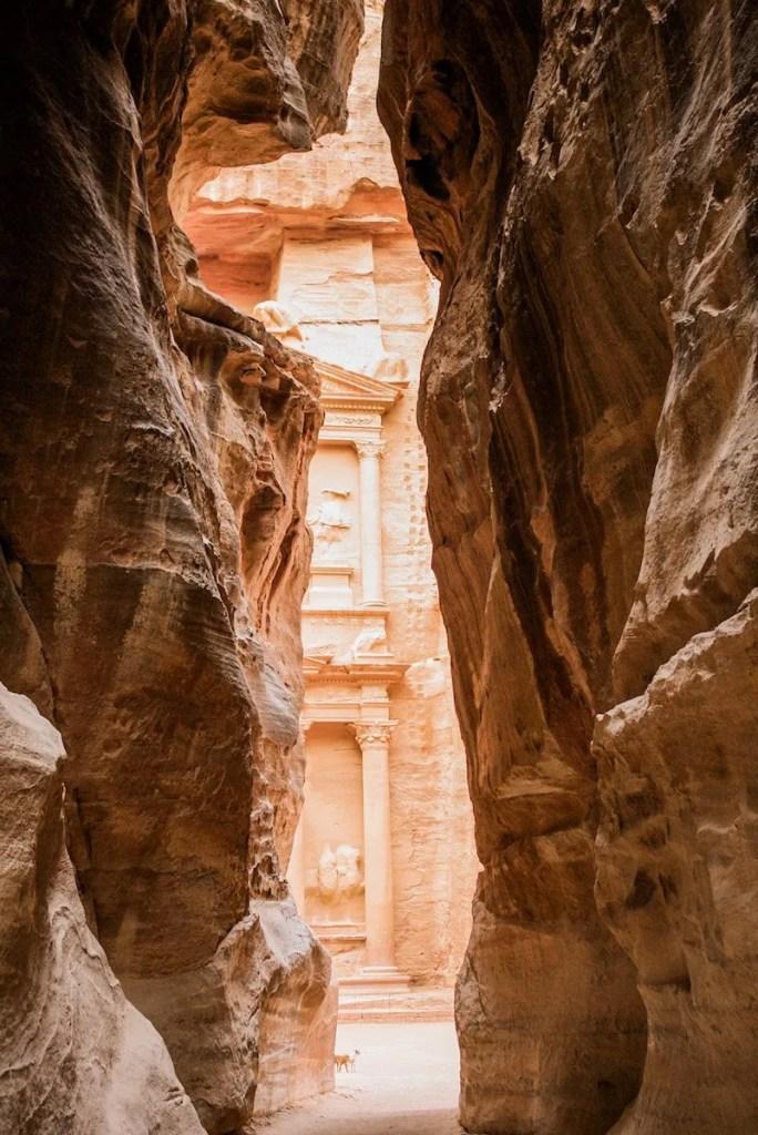 Peeking through the Siq towards the Treasury in Petra - Jordan itinerary