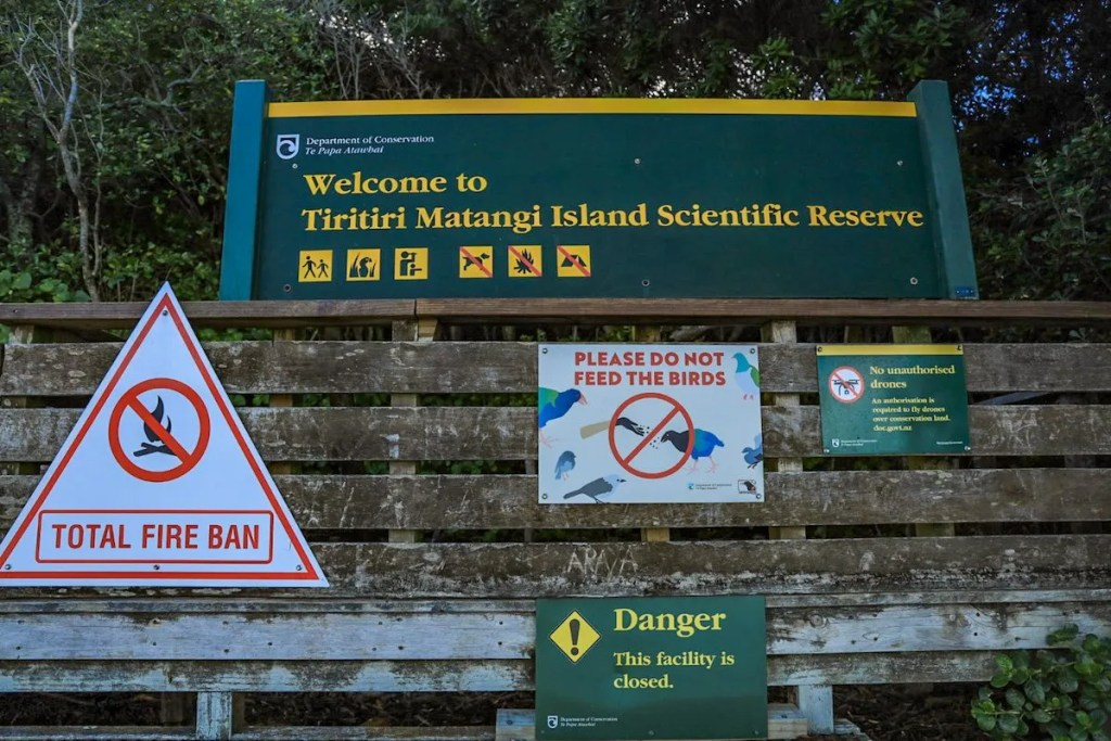 Welcome signs on Tiritiri Matangi - including signs prohibiting the feeding of the native birds.