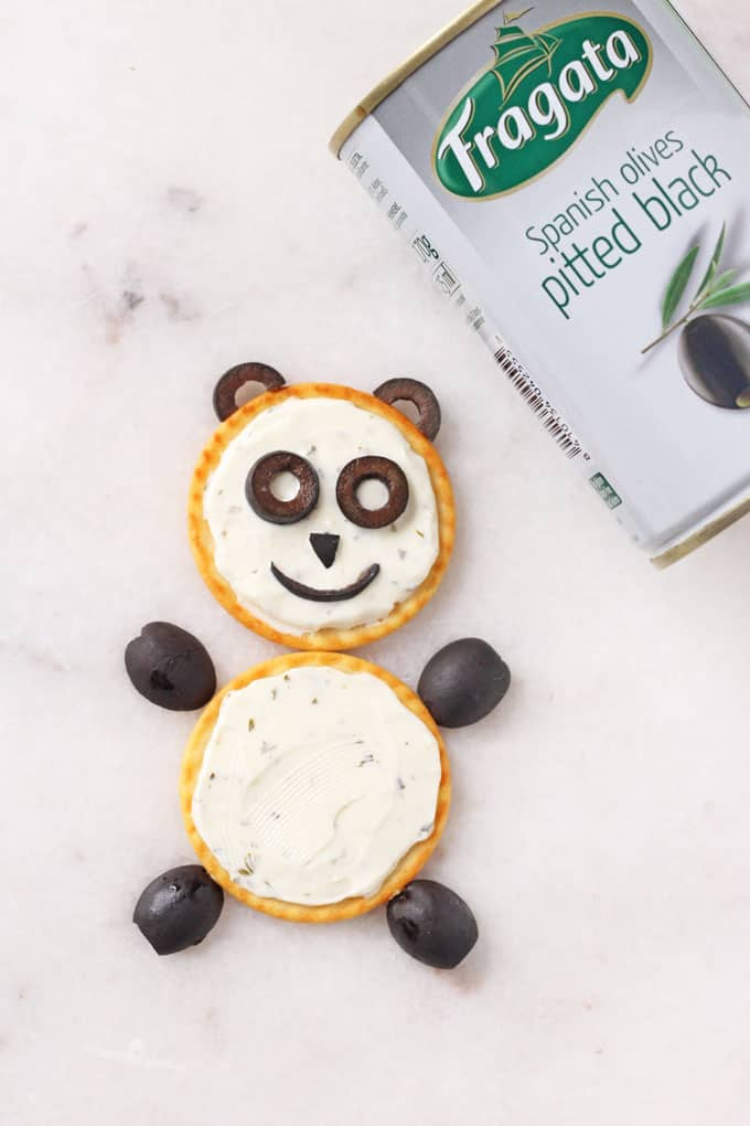 Make a fun and healthy snack for kids with just crackers, black olives and cream cheese | My Fussy Eater blog