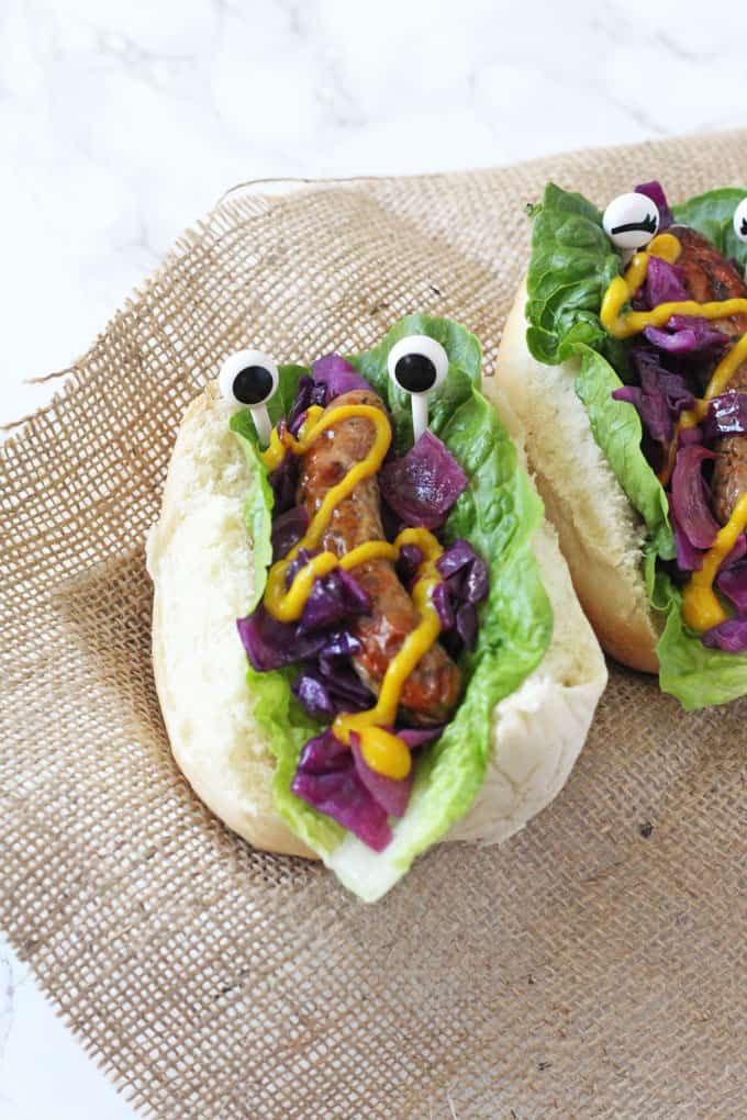 Have some fun with sausages and make these Monster Hot Dogs with red cabbage slaw. Perfect for Halloween or Bonfire Night!