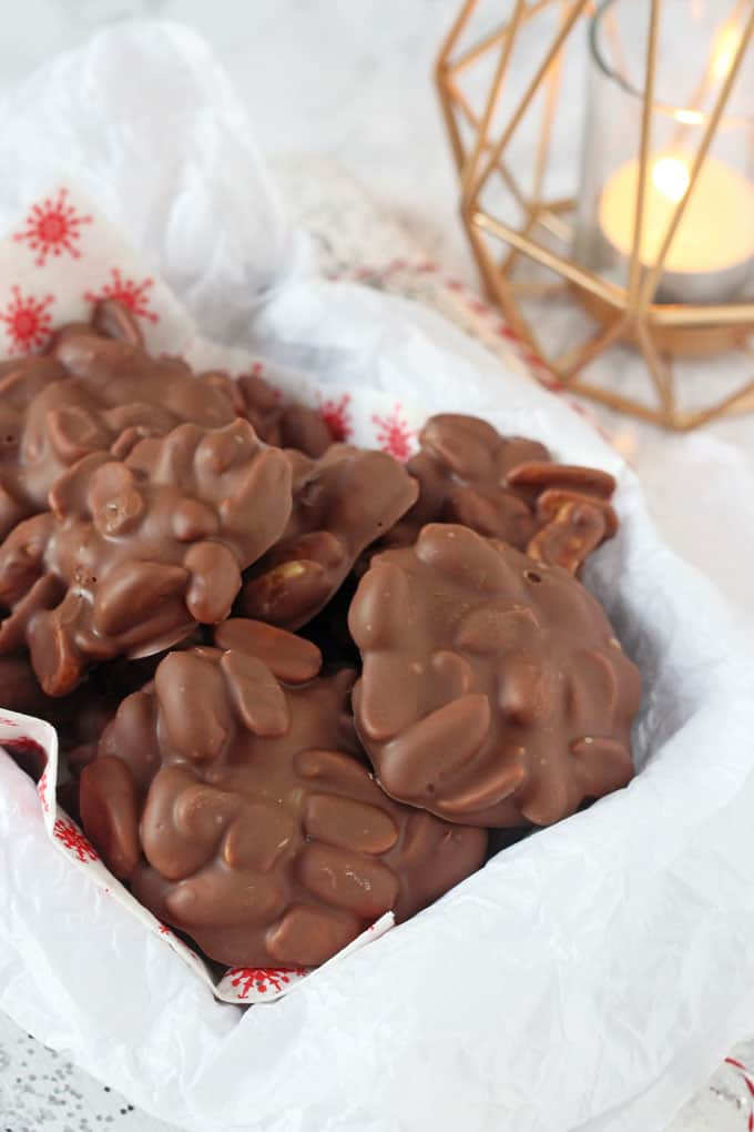 These super easy two ingredient Chocolate Peanut Clusters make the perfect last minute edible gift or snack idea this Christmas!