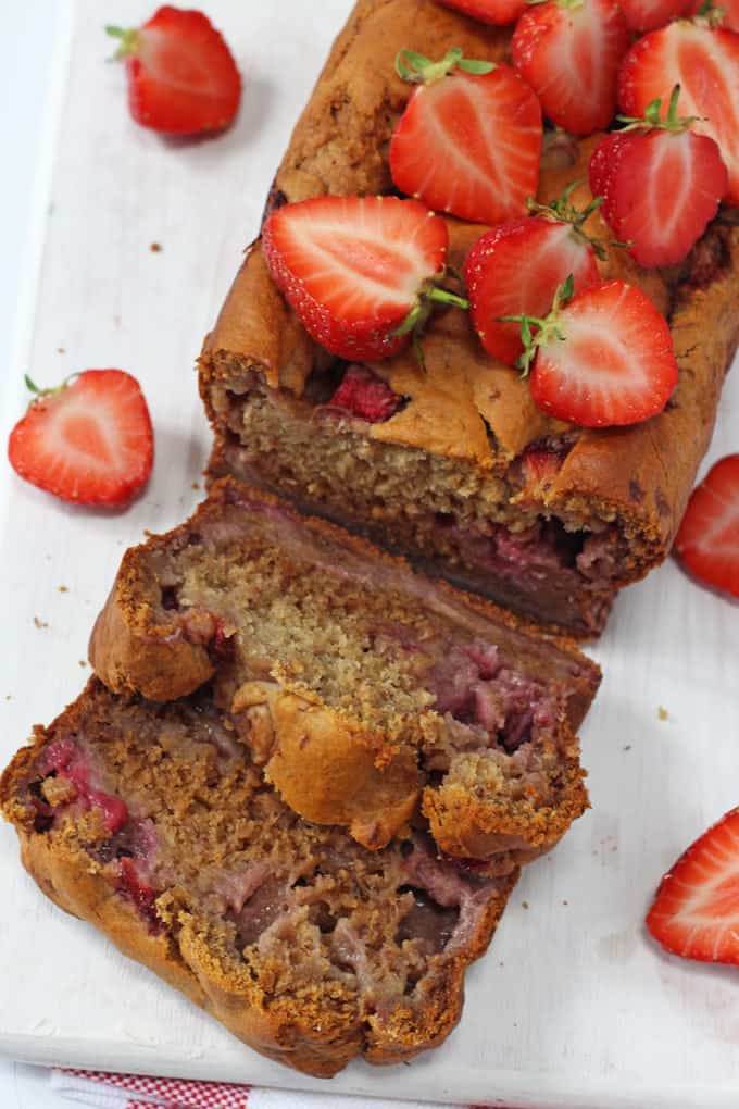 A delicious Strawberry Banana Bread recipe, made a little healthier with no refined sugar. The perfect afternoon snack for hungry kids!