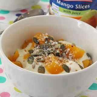 Princes Mango with Juice served with yogurt, seeds and coconut