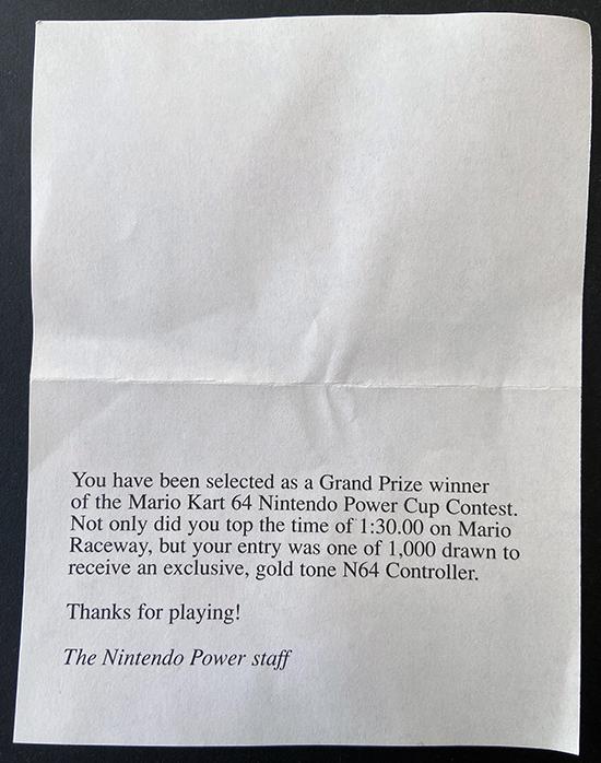 Mario Kart 64 gold controller note back