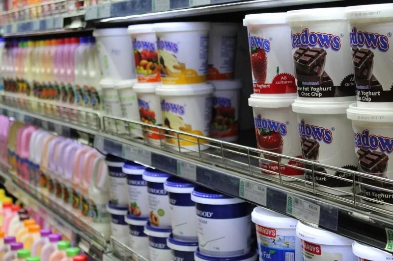 Yogurt in supermarket shelf