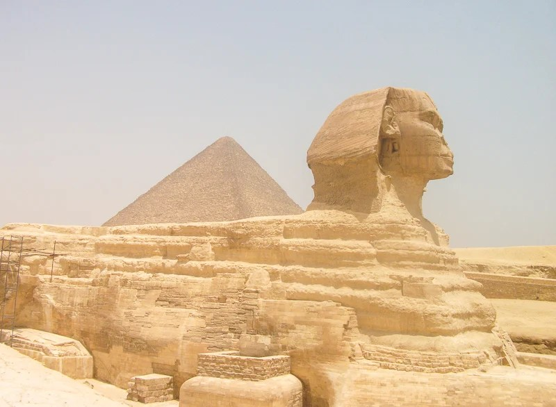 The Great Sphinx of Giza lies alongside the Great Pyramids of Egypt.