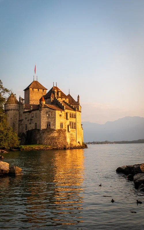 During my visit here over the summer, I went swimming in the crystal-clear waters around the castle. Just around sunset, it was incredible to see the sun's golden hues reflect on the castle and the lake - one of my favorite experiences from my recent trip to Switzerland!