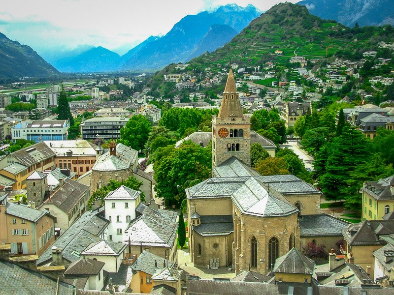 Sion is surrounded by mountains and vineyards.