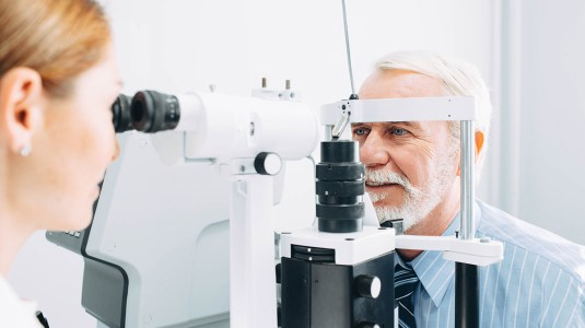 Senior man examined by an ophthalmologist