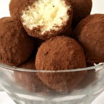 Coconut truffles dusted in cocoa powder