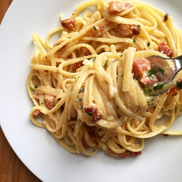A white plate of bacon carbonara recipe