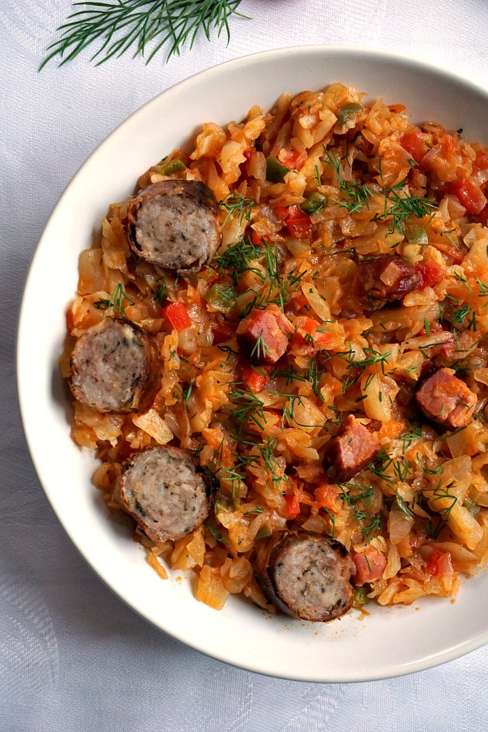 Braised cabbage with ham and sausages