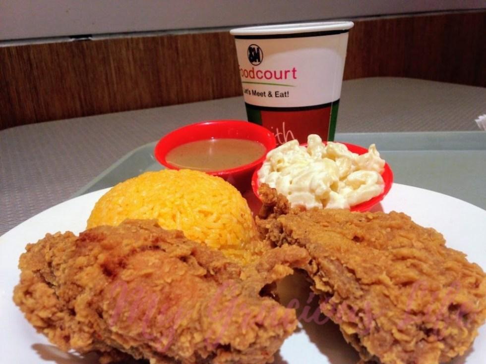 2 pieces kipp's chicken with spanish rice and macaroni salad