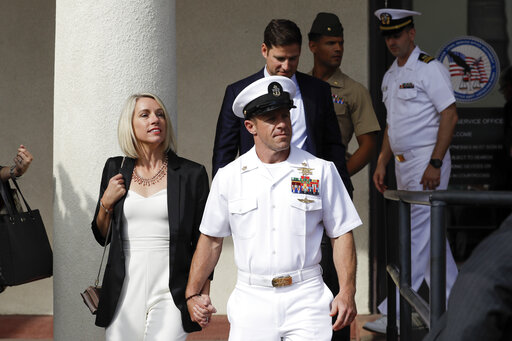 pretty nice 3f0da e6836 Navy Special Operations Chief Edward Gallagher, center, walks with his  wife, Andrea Gallagher, as they leave a military court on Naval Base San  Diego, ...