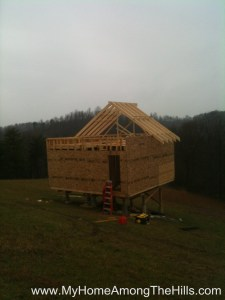 Half of the rafters done in our small cabin