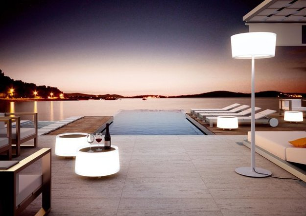 Outdoor living with pool and light table.