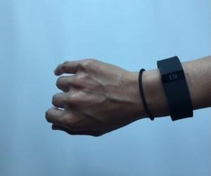 Black Fitbit Charge HR on female wrist