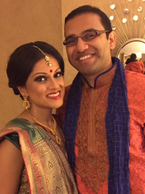Happy couple before sister's Hindu wedding ceremony