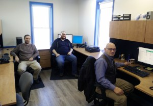 The guys are all smiles at the new office
