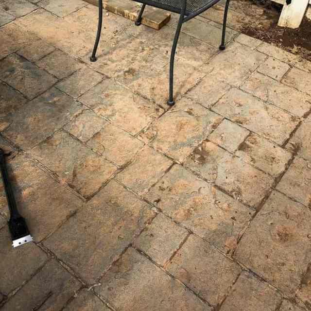 muddy patio needs power washing