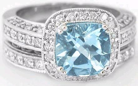 Cushion Cut Aquamarine And Diamond Halo Engagement Ring