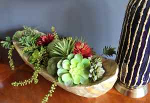 The homeowner has a green thumb, so plants and succulents were added in various places throughout the room.
