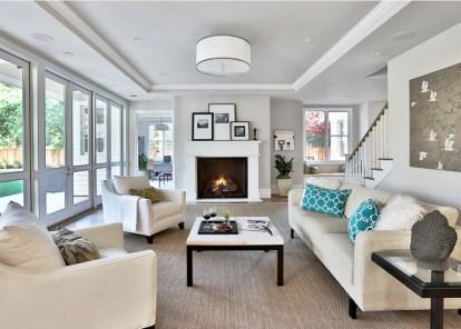 white-living-room-sofa-fireplace-coffee-table