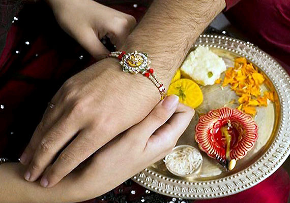 Following of rituals of Raksha Bandhan for celebrating the festival in 2015