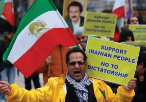 Iranian protester with sign