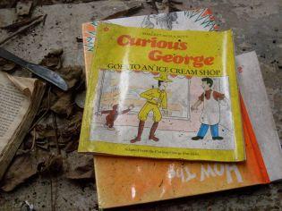 Children's books left by homeless inhabitant and her family.