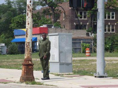 Man waits to cross Woodward Ave.