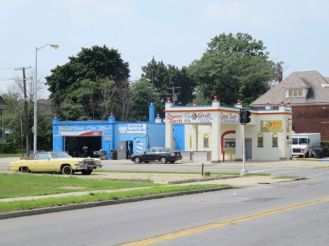 Freshly-painted service station near sight of Detroit Riots.