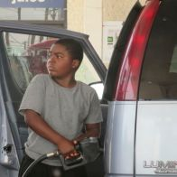 Ten-year-old pumps his own gas