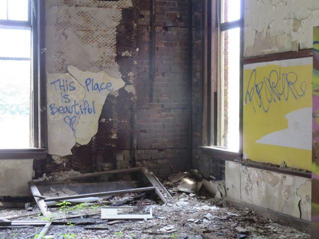 """This place is beautiful."" (graffiti from abandoned Caroline Crosman school)"